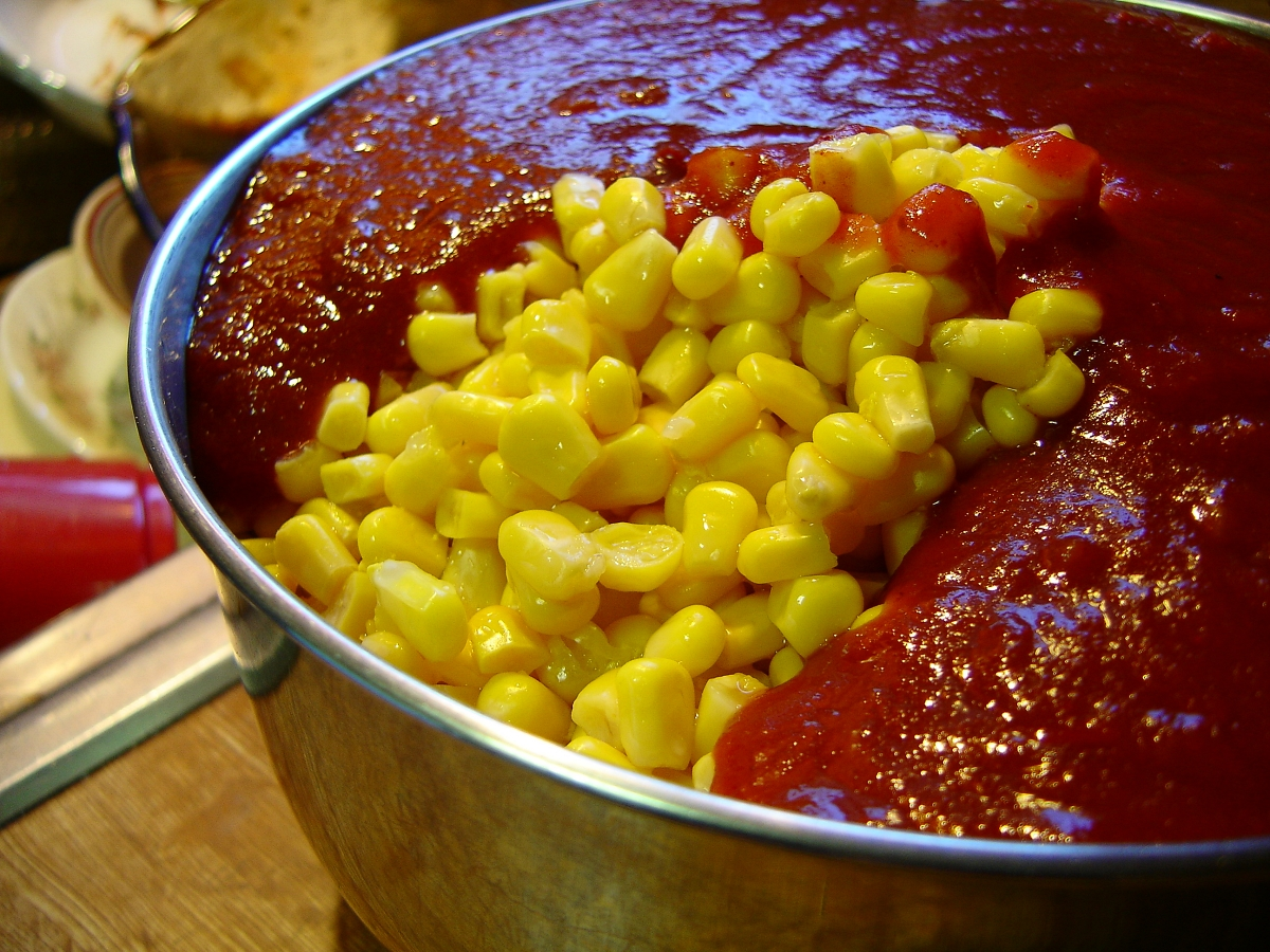 corn and tomato sauce in a pan