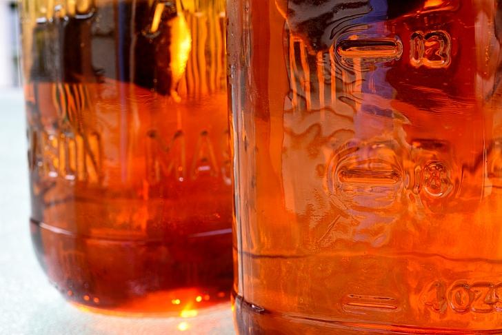 brewed black tea in jars