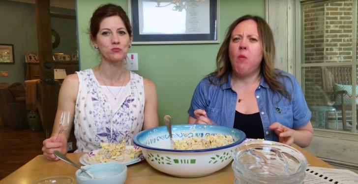2 women tasting popcorn salad with bacon