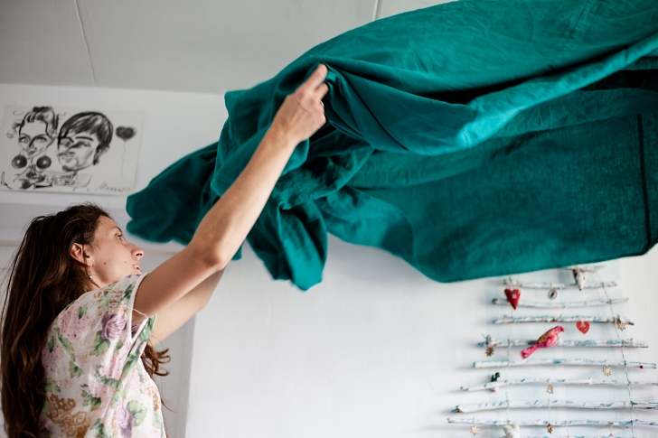 woman changing bedding