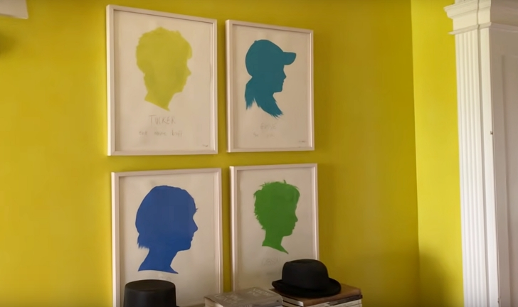 silhouette paintings on yellow wall