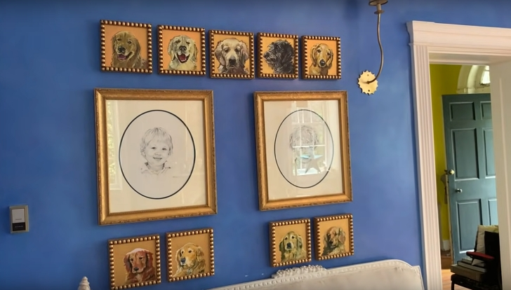 blue wall with paintings of dogs