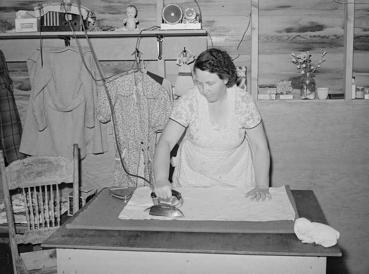 woman ironing clothes, 1941
