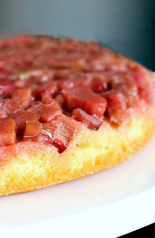 Vertical photo closeup of strawberry rhubarb upside down cake round