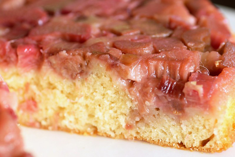 Extreme close up of a slice of strawberry rhubarb upside down cake