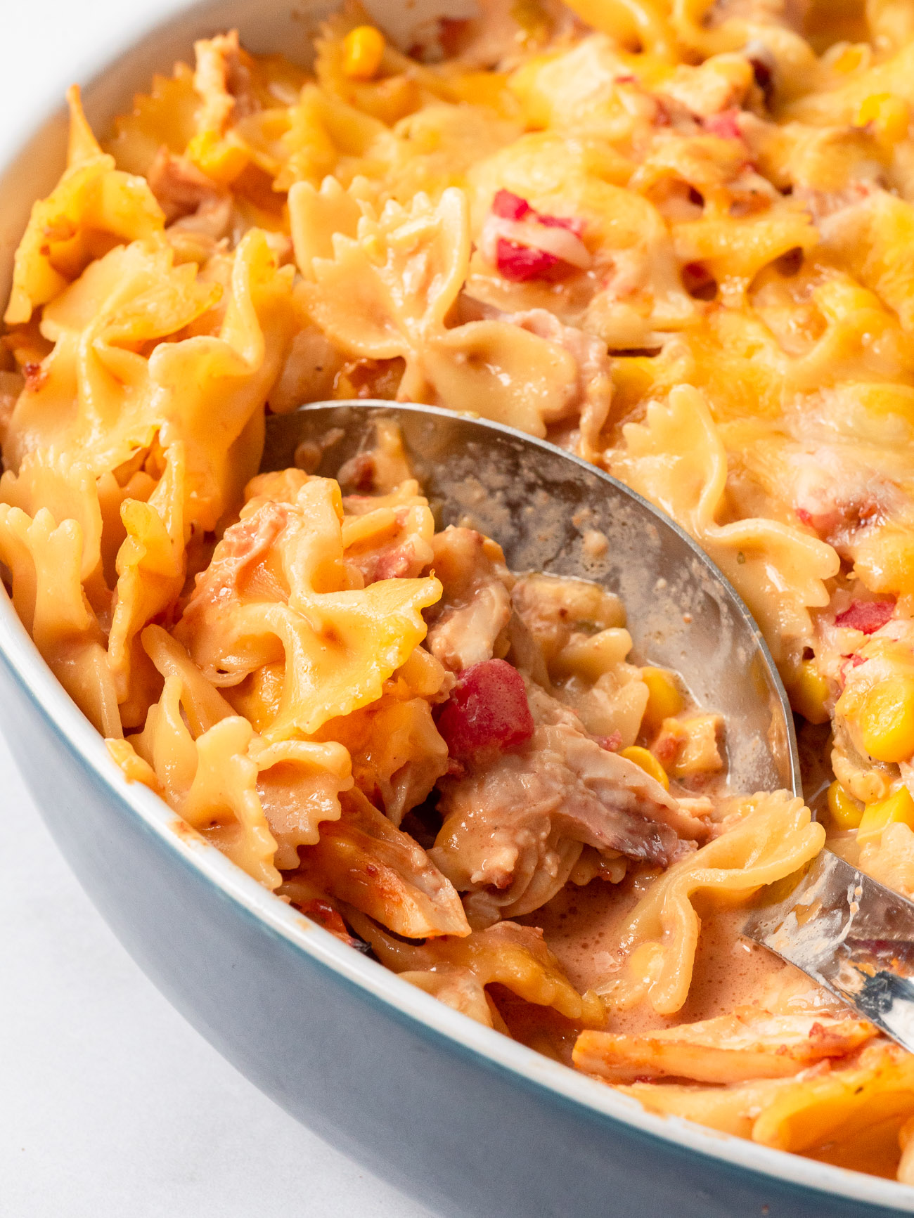 BBQ Ranch Chicken casserole in a dish with a spoon