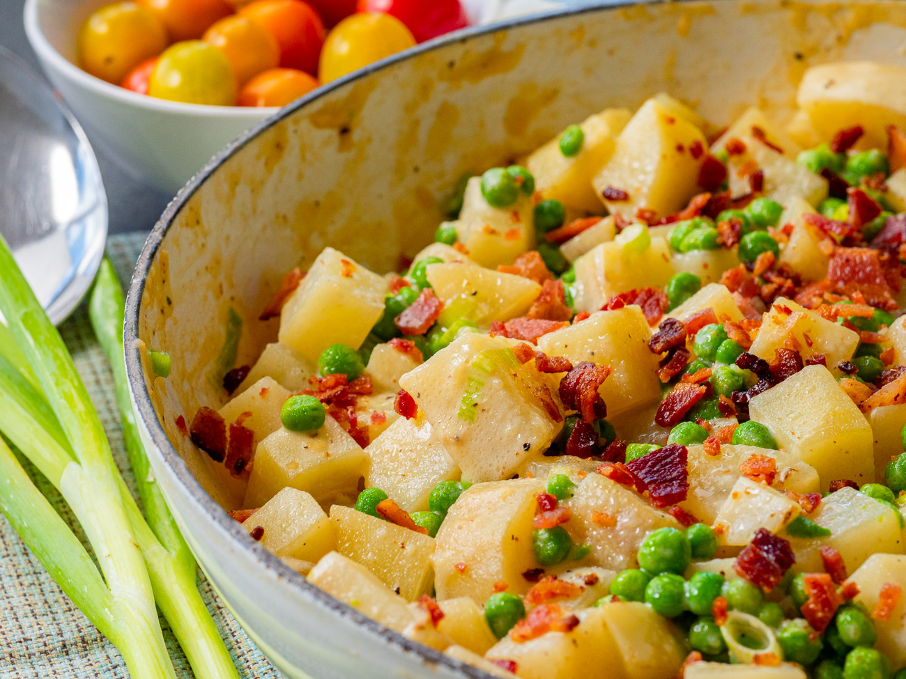 Close up of pot with potatoes, peas, and bacon