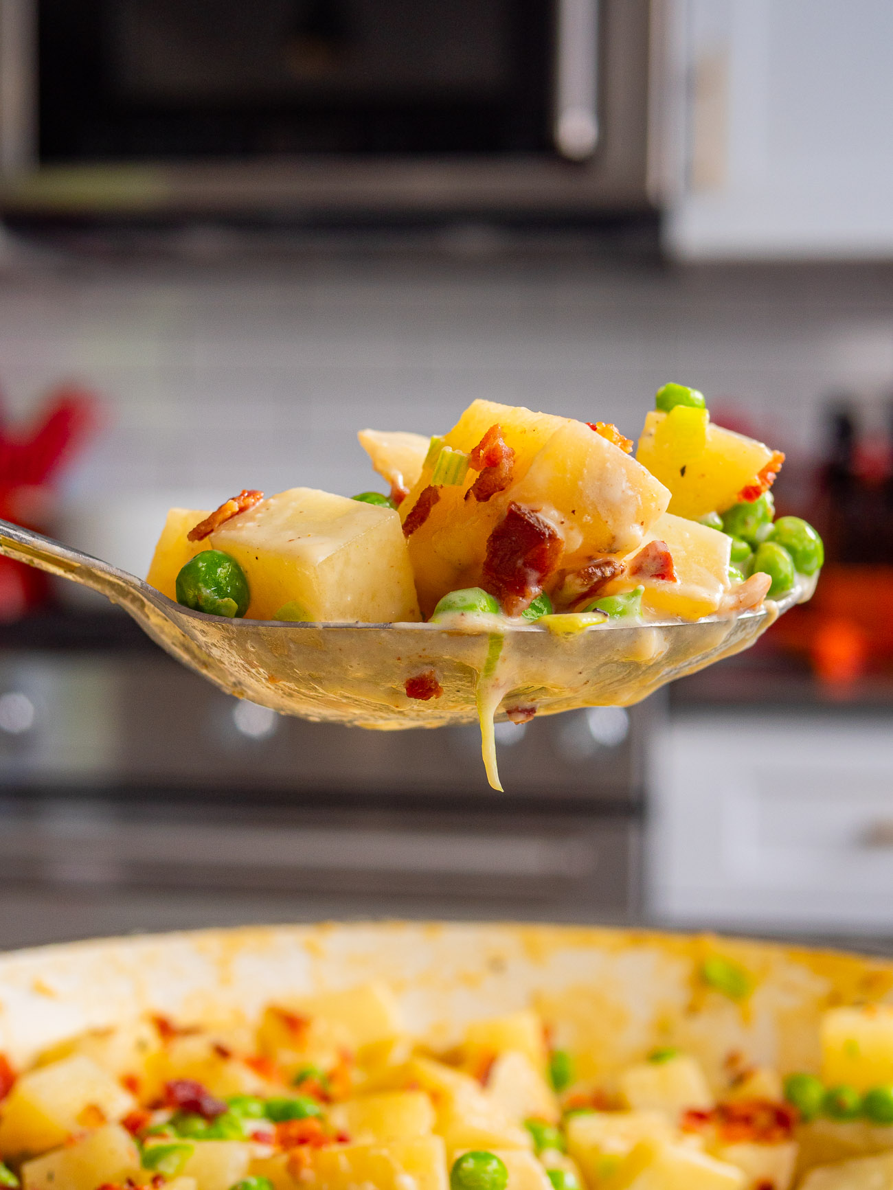 Spoonful of creamed peas and potatoes