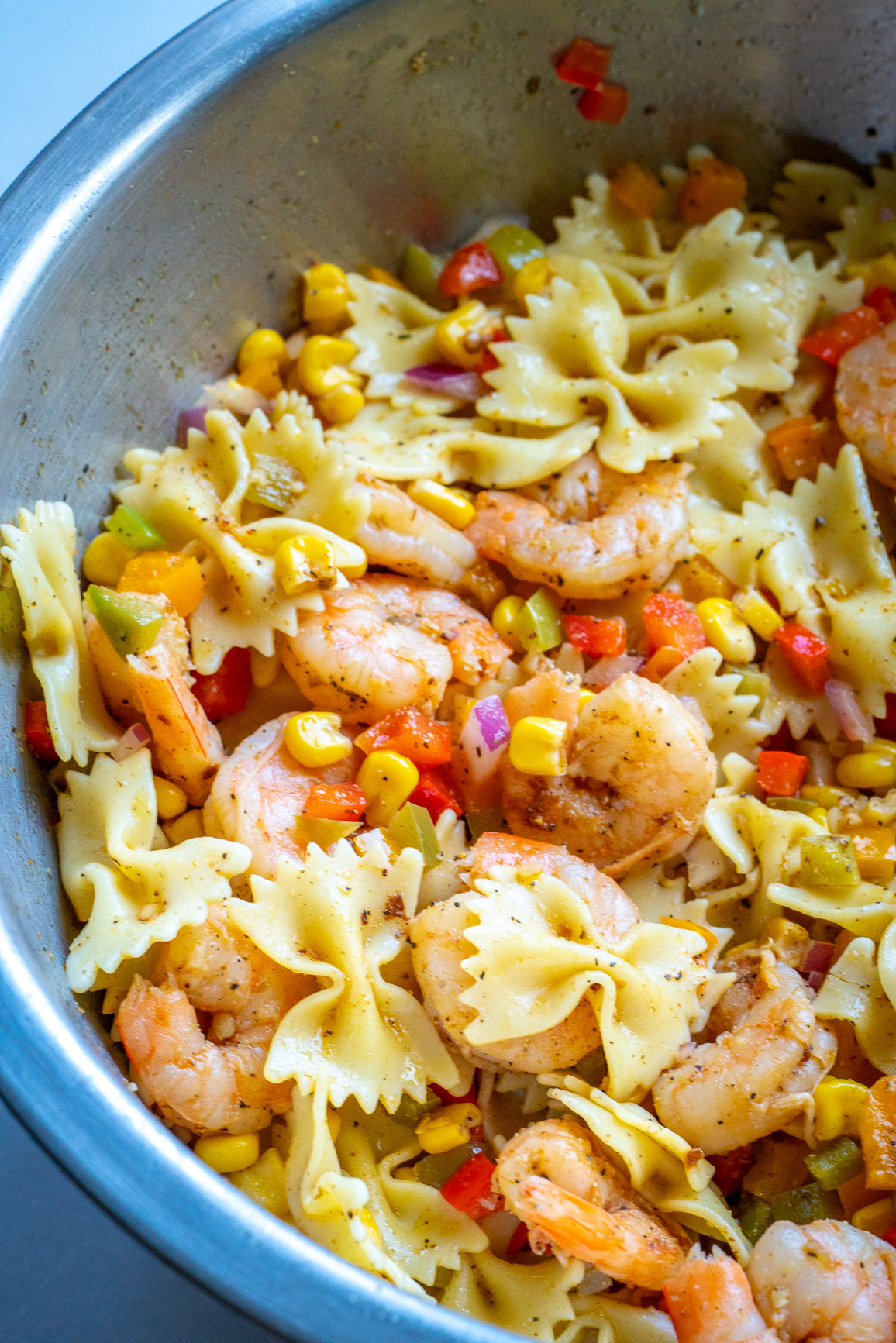 Shrimp fajita salad in a large bowl