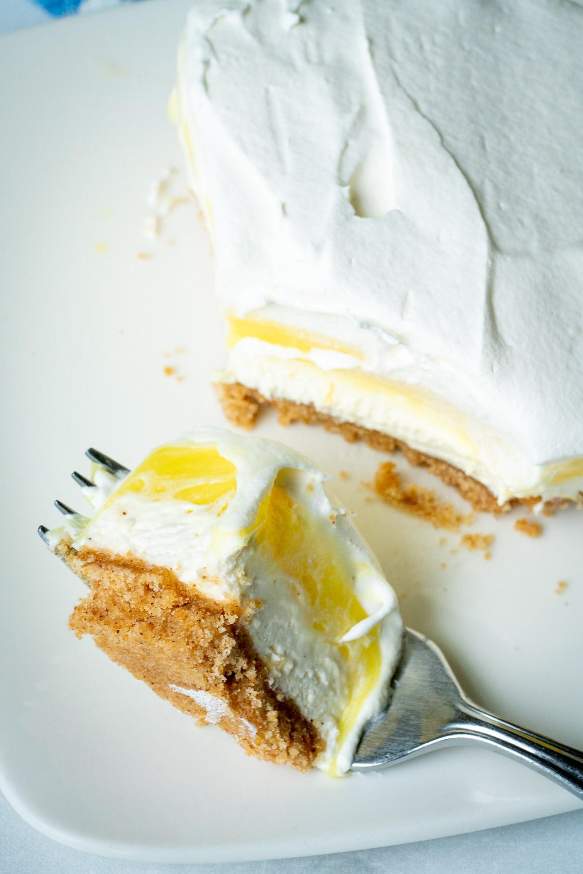 Bite of lemon lush on a fork