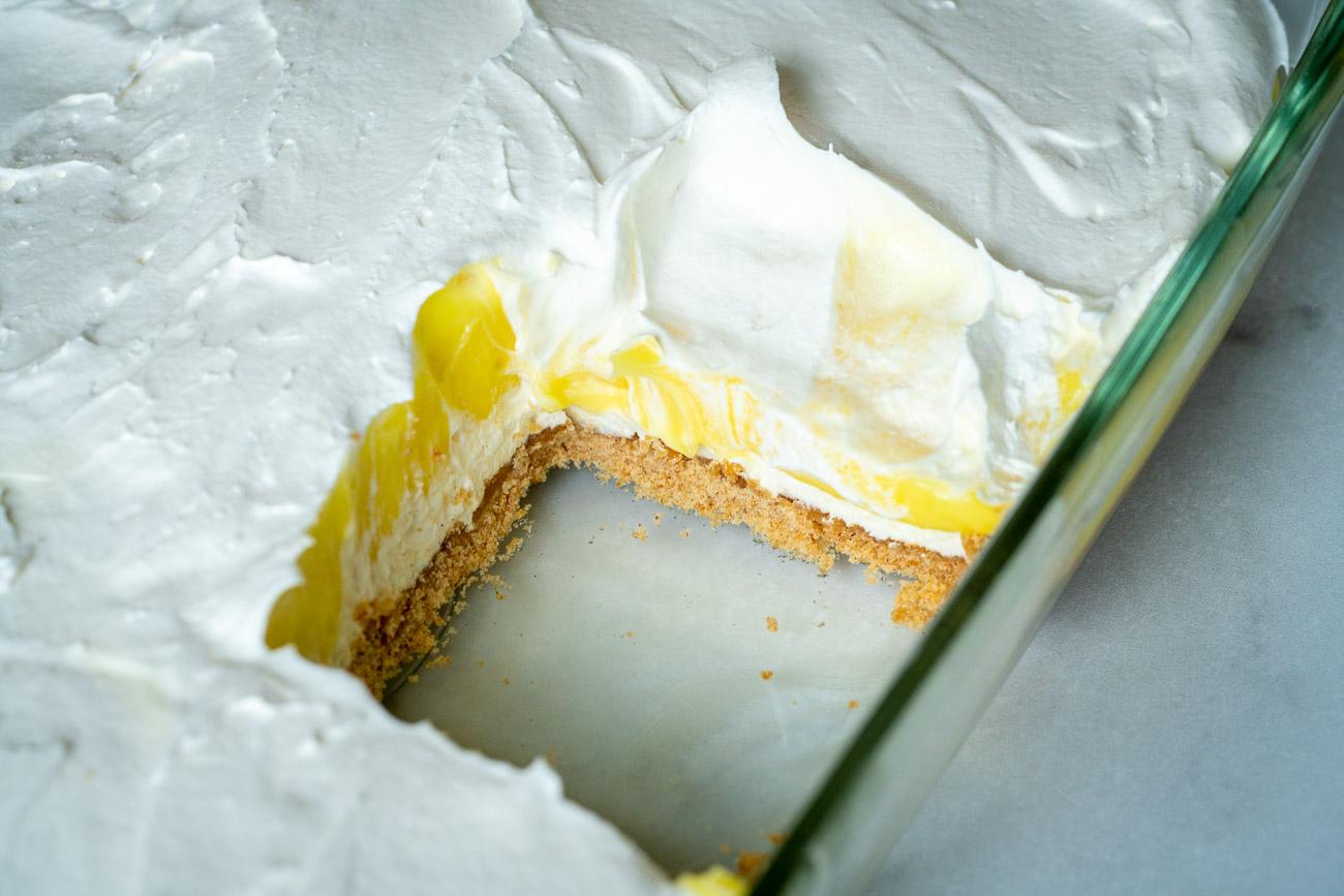 A slice of lemon lush taken out of the pan