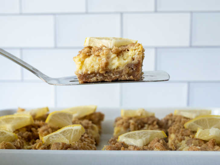 Lemon bar being lifted from pan