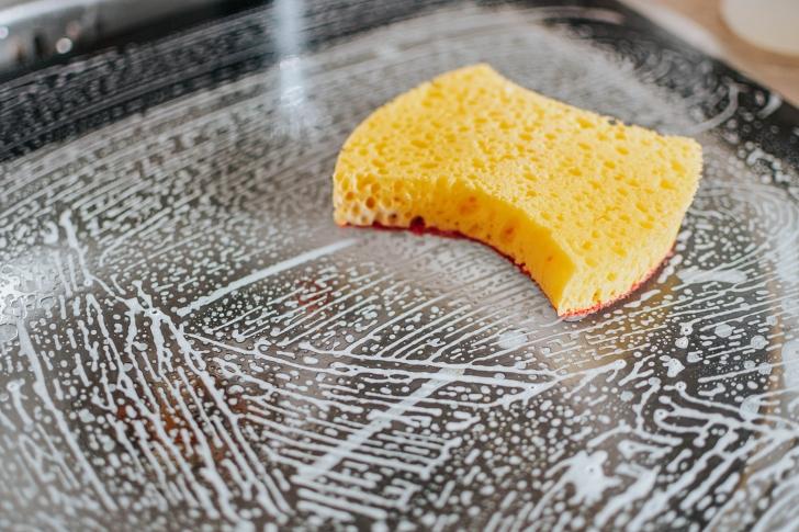 soapy sponge in sink