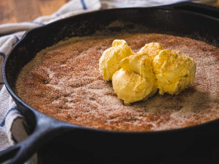 Close up of cake in a skillet with ice cream on top