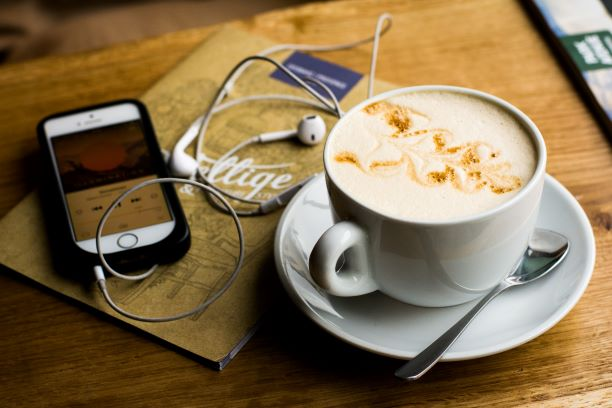 coffee and earbuds