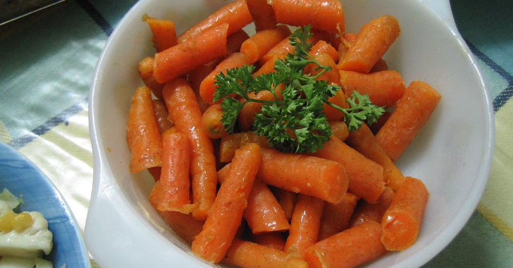 Top down of cooked carrots and parsley