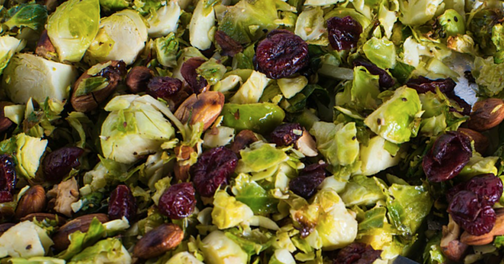 close up of brussles sprouts, cranberries, and nuts