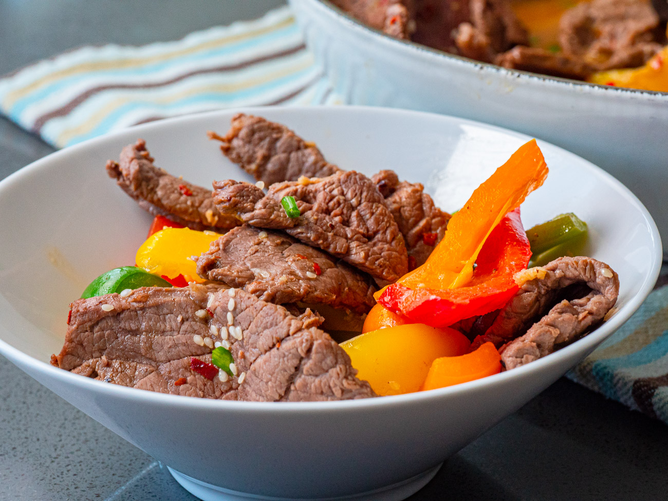 A bowl of steak and peppers
