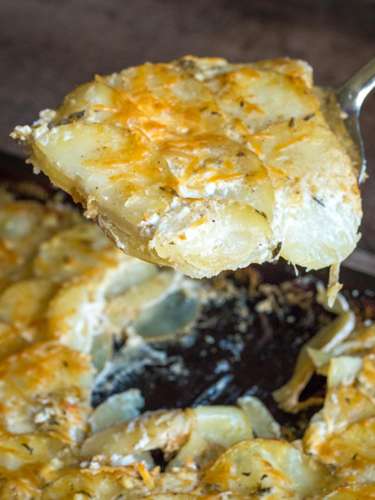 Big scoop of creamy sheet pan potatoes