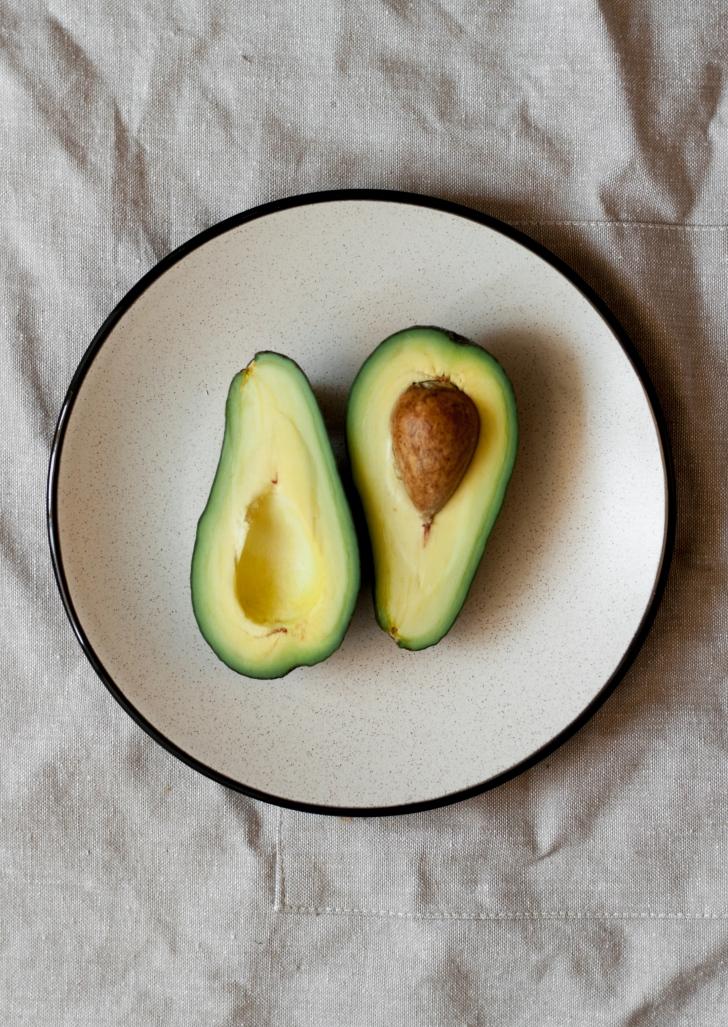 halved avocado on a plate