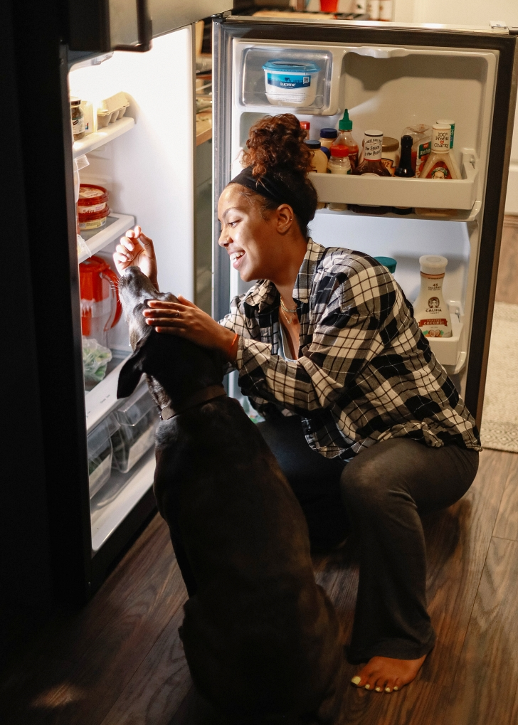 woman looking into her fridge