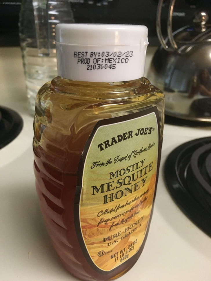 honey bottle on stovetop