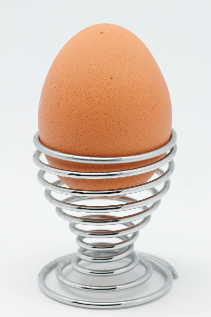 soft boiled egg in metal egg cup