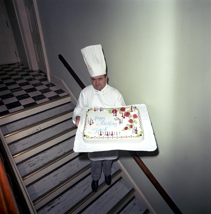 Rene Verdon holding the cake for JFK birthday
