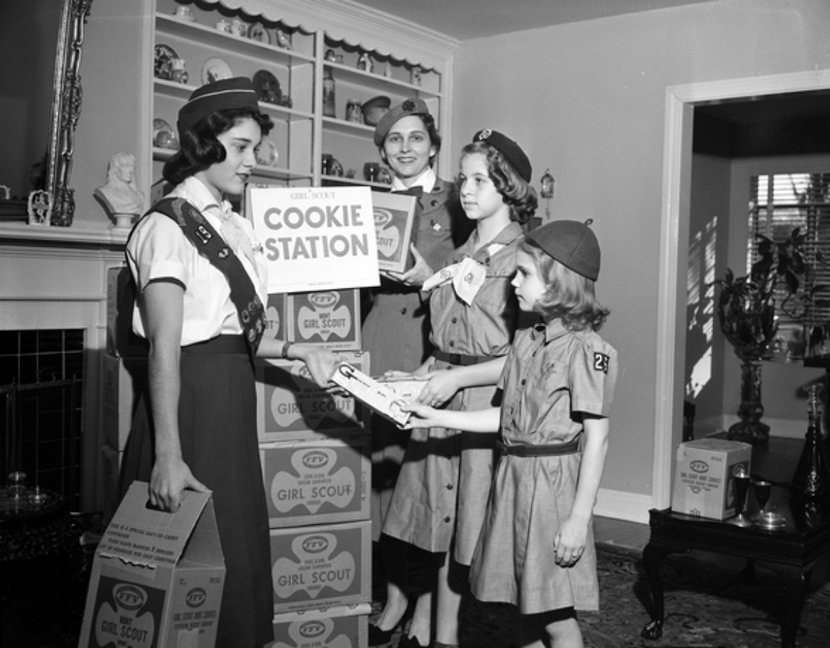 girls scouts with boxes of cookies 1959
