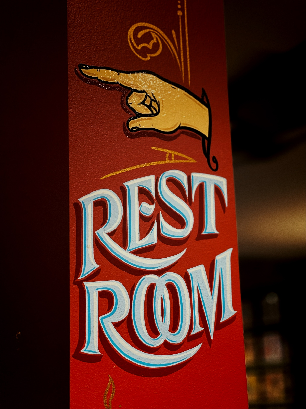 painted restroom sign