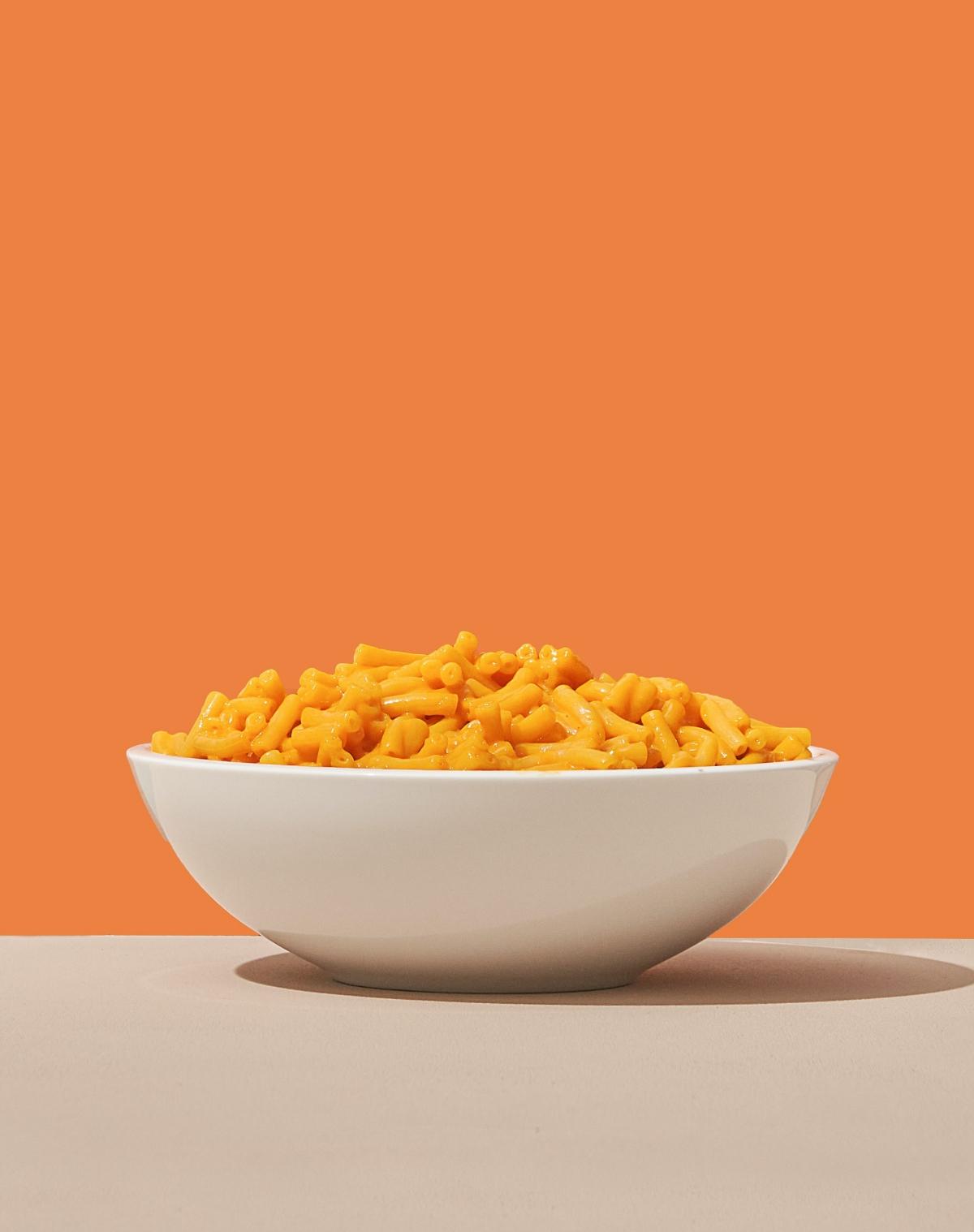 mac and cheese on orange background