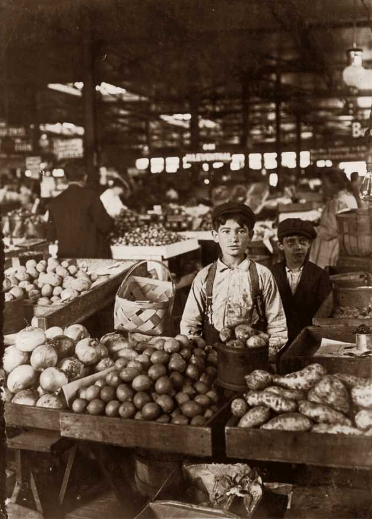 young boys working in a grocery at the turn of the 20th century