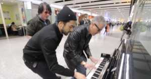 3 musicians entertain weary travelers in London airport