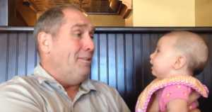 baby and grandpa have an in depth conversation