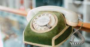 vintage phone with elaborate velvet cover