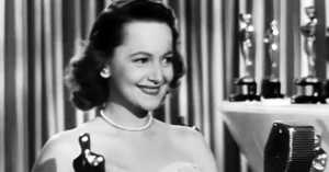 Olivia de Havilland accepting the Oscar for Best Actress in a Leading Role for To Each His Own in 1947