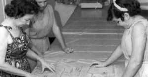girls learning pattern cutting in home ec, 1960s