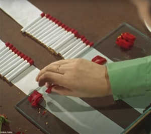 making rose petal tipped cigarettes in the 1950s