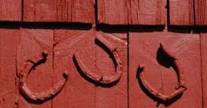red horseshoes on a red building exterior