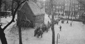 Nazi police gather to arrest Jews in the Feb 1941 razzia round up in Amsterdam