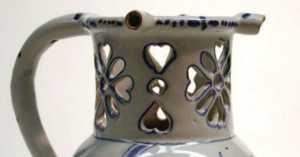 antique puzzle jug