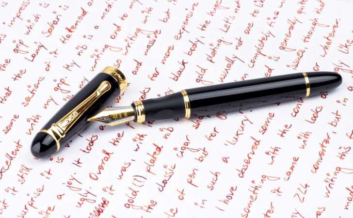 fountain pen resting atop a page of writing