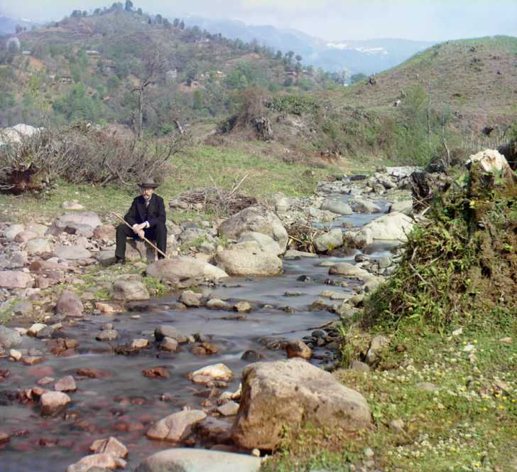 Self portrait of Prokudin-Gorskiĭ sitting on the banks of the Skuritskhali River, Orto-Batum village near Batumi, Georgia
