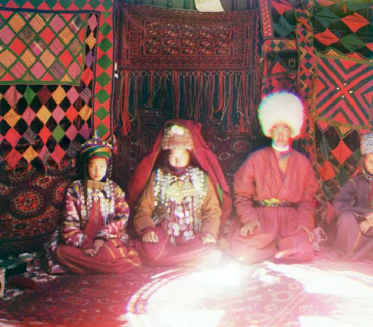traditional clothing seen on Eurasian people inside a yurt, early 1900s
