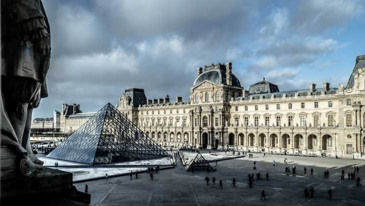 the Louvre on a cloudy day