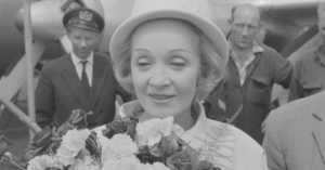 Marlene Dietrich with a bouquet of flowers, 1962