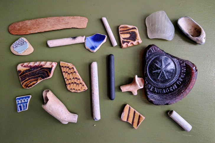 mudlarking finds including pipes and pottery shards