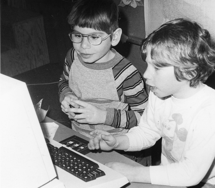2 kids using an early pc
