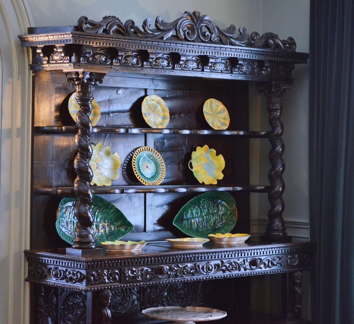 china hutch with decorative serving pieces on top