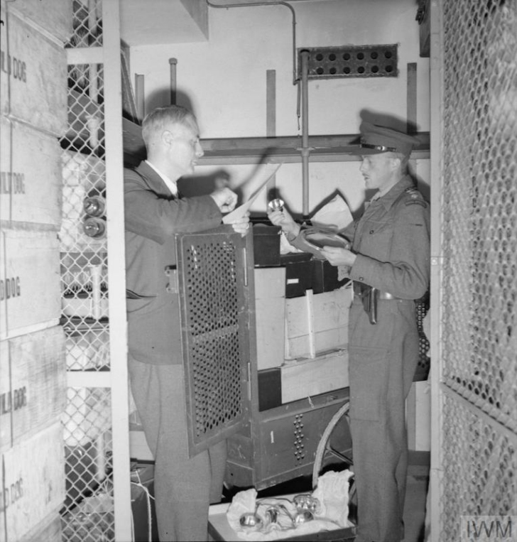 English captain inspecting looted silver in the Reichsbank safe rooms